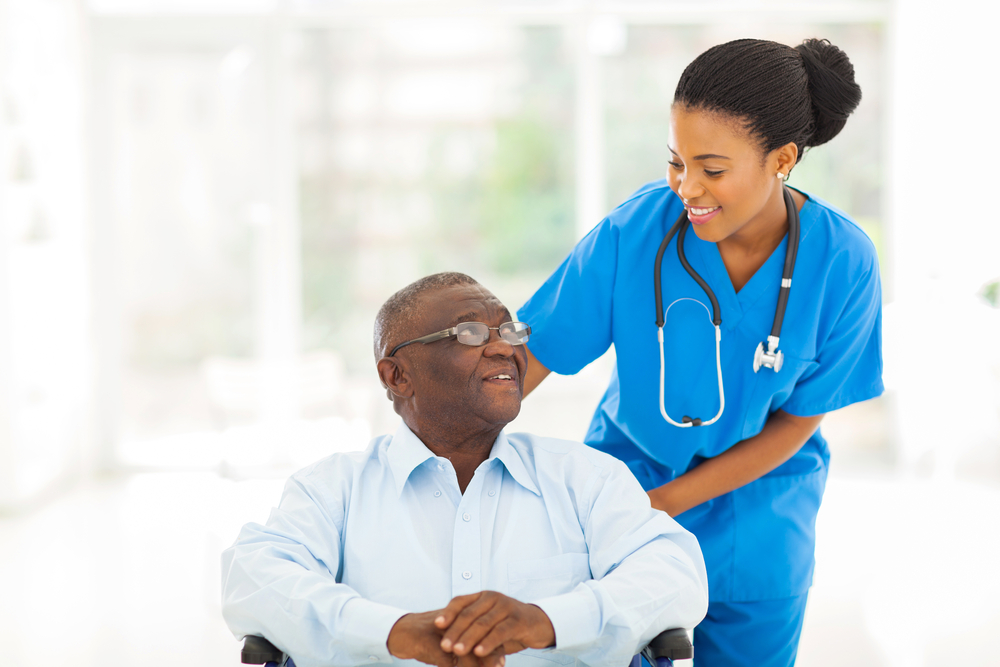 A doctor cares for an elderly patient