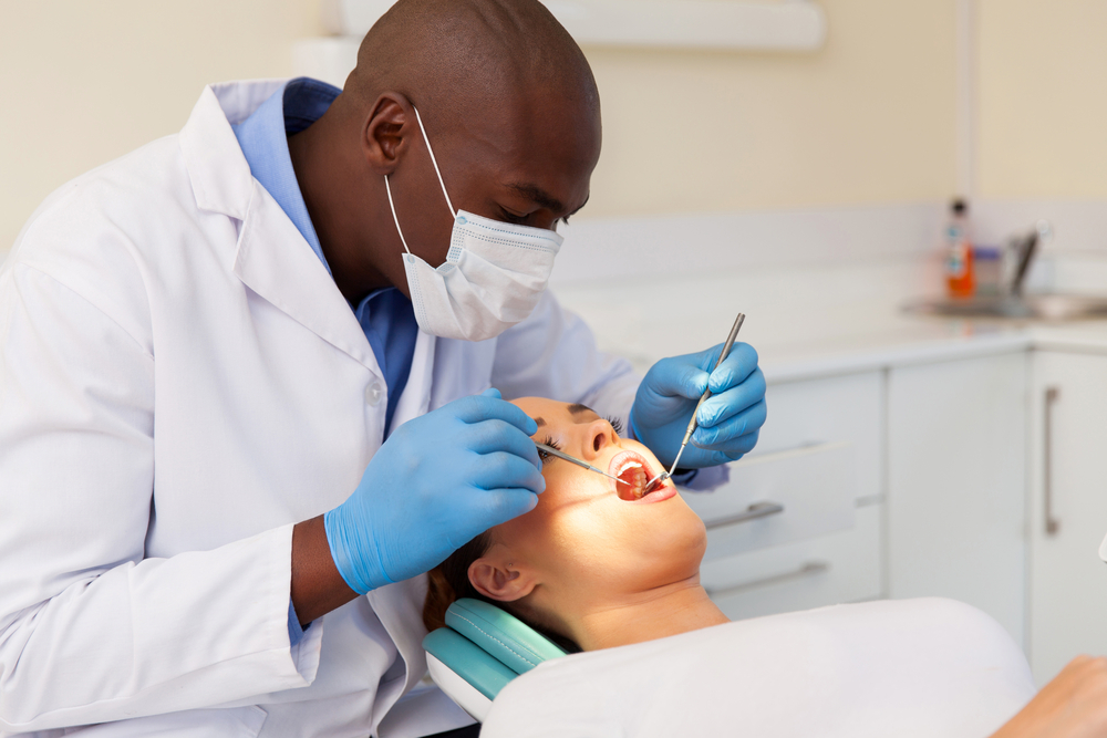 A dentist performs a checkup