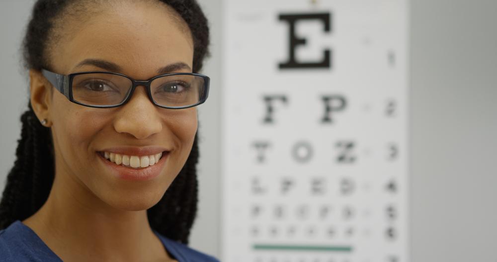 An eye doctor prepares a vision test
